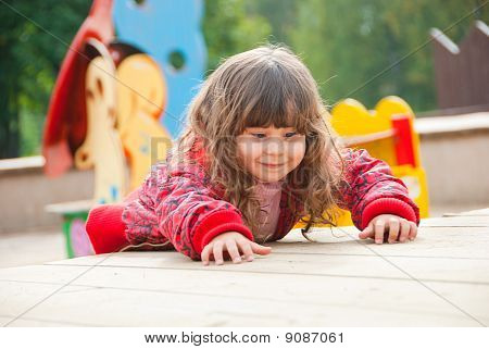Little Girl Plays In Playground