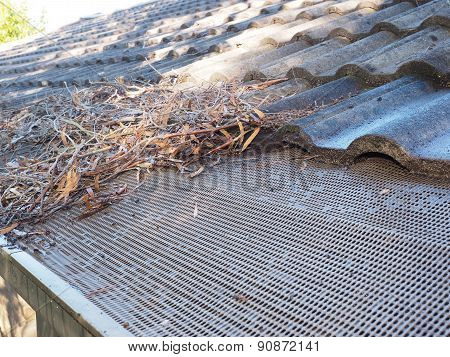 Roof gutter in the process of cleaning debris
