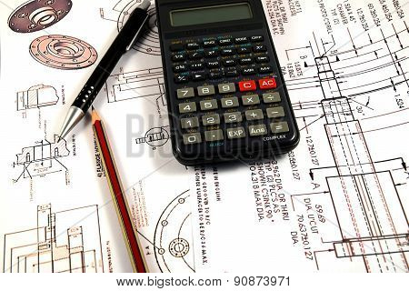 Scientific calculator, Pen and Pencil over the Engineering Drawing Map