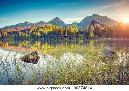Fantastic mountain lake in National Park High Tatra. Strbske pleso, Slovakia, Europe. Dramatic unusual scene. Beauty world. Retro and vintage style, soft filter. Instagram toning effect.