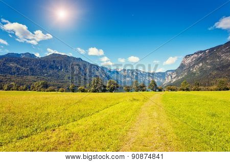Fantastic panorama on the Triglav national park, located in the Bohinj Valley of the Julian Alps. Sky glowing by sunlight. Dramatic unusual scene. Slovenia, Europe. Beauty world.