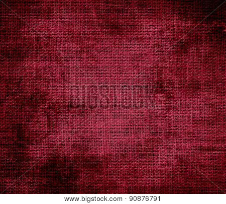 Grunge background of burgundy burlap texture