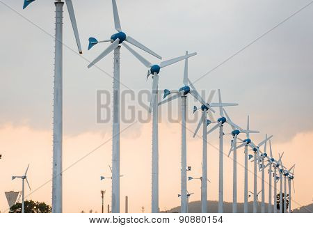 Wind Power Station Against And Light Sunset