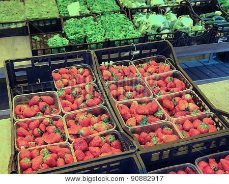 Red Strawberries And Vegetables In The Grocery Store
