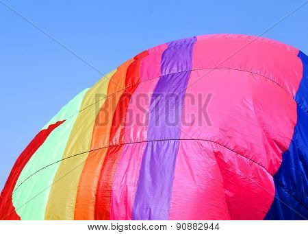 Colorful Hot Air Balloon Flies In Sky Blue