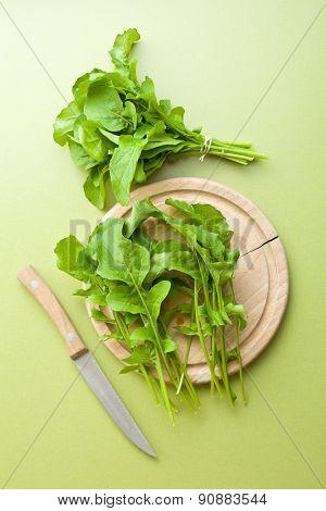arugula leaves on kitchen table