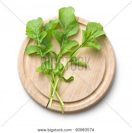 the arugula leaves on cutting board