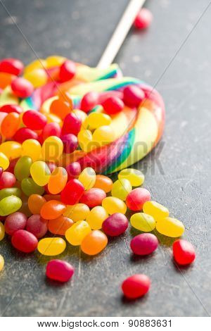 colorful confectionery on old black table