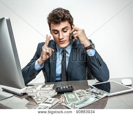 Successful Businessman Talking By Cellphone While Working With Pc Computer And Calculator