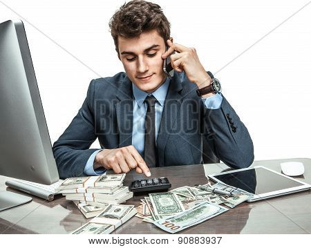 Successful Businessman Talking By Mobile Phone While Working With Pc Computer And Calculator