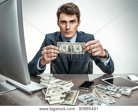 Depressed Businessman Dissatisfied With His Earnings, Profit, Income, Gain, Benefit, Margi