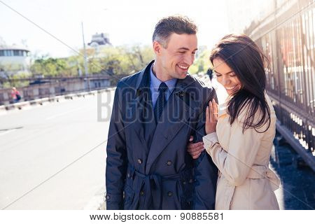 Smiling funny couple walking outdoors