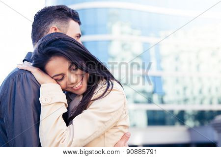 Happy young couple in love embracing outdoors