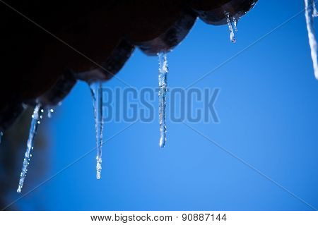 icicles and snow on alps cottage