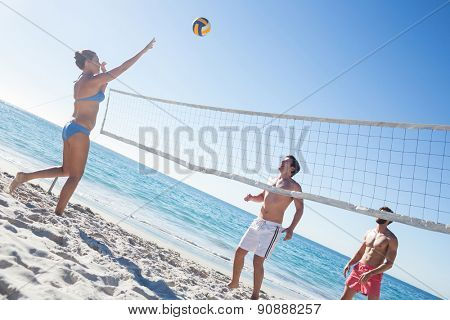 Friends playing volleyball at the beach