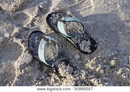 Sandy Flip Flops Left On The Beach