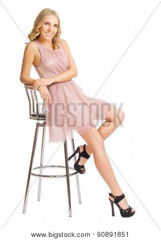 Young girl sit on metallic chair isolated