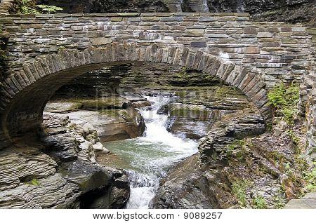 Stone Bridge Over Waterfall