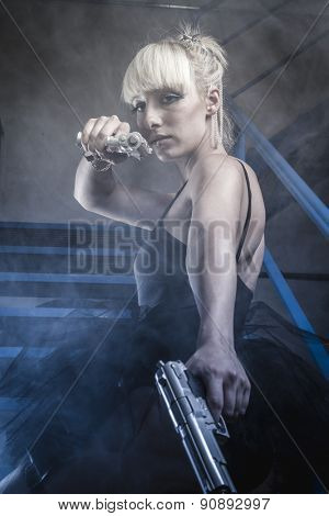 Blonde with pistols and dressed in costume ballet dancer