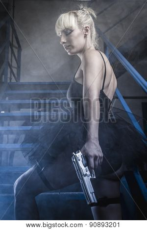 Armed blonde with pistols and dressed in costume ballet dancer