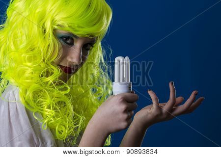 Technology, concept electricity, young girl with a light bulb in hand