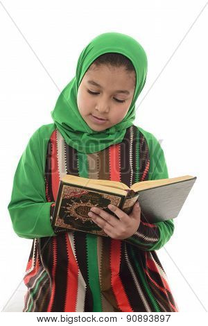Little Young Muslim Girl Reading Holy Quran