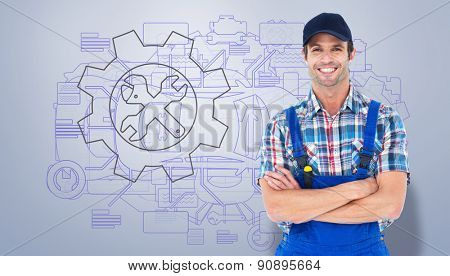 Confident plumber with arms crossed against grey vignette