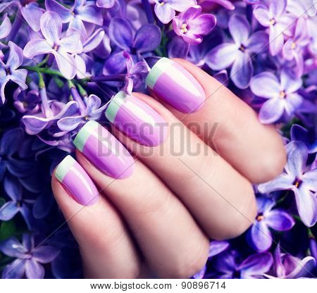 Manicured nails Nail Polish art design. Violet with green colors Art Manicure. Nail Polish. Beauty hands. Fashion Stylish Trendy Colorful Nails