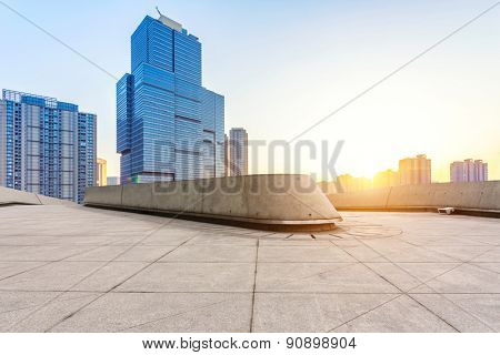 Empty floor and modern building with sunbeam