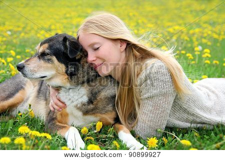 Woman Tenderly Hugging German Shepherd Dog