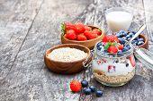 pic of oats  - fresh yogurt with oat flakes and berries - JPG
