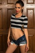 picture of bare midriff  - Beautiful young multiracial woman in a striped midriff tee shirt - JPG