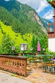 picture of giannena  - Small Alpine restaurant on the terrace on the background of the Alps - JPG