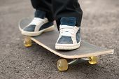 pic of skateboarding  - Teen skateboarder riding a skateboard in the street - JPG