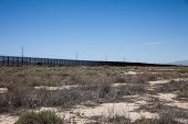 pic of smuggling  - The border fence near El Paso - JPG