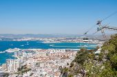 stock photo of gibraltar  - View of the city of Gibraltar and cable car close to the top of Gibraltar rock - JPG
