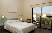 pic of larnaca  - basic budget simple modern hotel room with patio view of church larnaca cyprus mediterranean - JPG