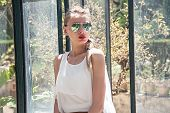 picture of fascinating  - Portrait of beautiful blonde woman wearing sunglasses - JPG