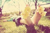 foto of toe  - Child with Daffodils between his toes - JPG