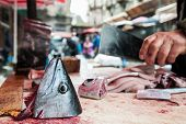 pic of fish  - Cut head of a tuna fish on the work table of a fish seller cutting it into slices fish market Catania Sicily - JPG