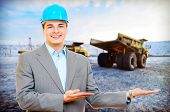 stock photo of jcb  - Photo of a mining engineer on industrial background - JPG