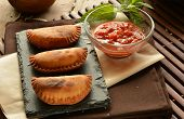 foto of patty-cake  - homemade tuna patty with tomato sauce on wooden table - JPG
