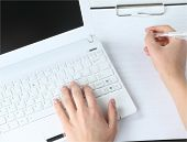 image of qwerty  - Human hands working on laptop on office background - JPG