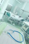 stock photo of intensive care  - ECG and stethoscope on the background severely ill patients in intensive care  - JPG