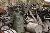 image of gas mask  - Man with gas mask and green military clothes explores after chemical disaster - JPG