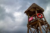 foto of lifeguard  - Lifeguard tower at mexican beach with safety bouye - JPG