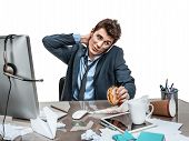 foto of loafers  - Businessman scratches his head at working place sloth and laziness concept - JPG