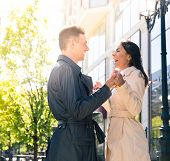 picture of flirt  - Laughing young couple flirting outdoors - JPG