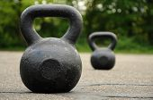 picture of kettlebell  - kettlebell of 32 kilo in the front and 24 kilo in the back - JPG