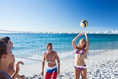 picture of volleyball  - Group of friends playing volleyball at the beach - JPG